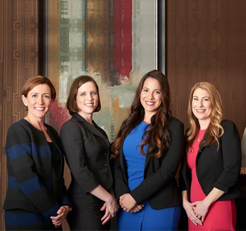 Katie Bain, Laura Mazza, and Katherine Debski of Bain Mazza & Debski LLP and another woman